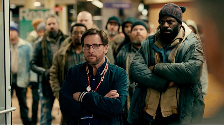 "A still image from ""The Public"" featuring Emilio Estevez as Stuart Goodson and Che ""Rhymefest"" Smith as Big George. ""The Public"" title is a reference to a public library in Cincinnati. When an Arctic cold freezes the city, a group of homeless people decide to hold an ""occupy"" movement and camp out in the library. (Universal Pictures)"