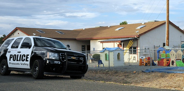 Police search the Gummy Bear Early Learning Center, in the 8000 block of Manley Drive, Prescott Valley, Thursday evening, July 11, 2019, as part of an investigation into complaints of child abuse. They also searched an associated Gummy Bear Childcare business on Spouse Drive. (Tim Wiederaenders/Courier)
