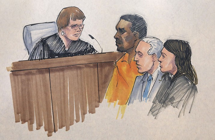 In this courtroom sketch, R&B singer R. Kelly, center, appears before U.S. Magistrate Shelia M. Finnegan, left, in U.S. District Court for the Northern District of Illinois. Friday, July 12, 2019, in Chicago. Also standing with Kelly is his attorney Steve Greenberg and an unidentified prosecutor. (Tom Gianni via AP)