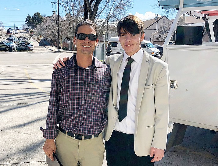 Kenneth Moran Jr. (right), 19, with his dad, Kenneth Moran Sr., outside the Yavapai County courthouse in Prescott after a court hearing for Kenneth Jr. in early June. (Kenneth Moran Sr./Courtesy)