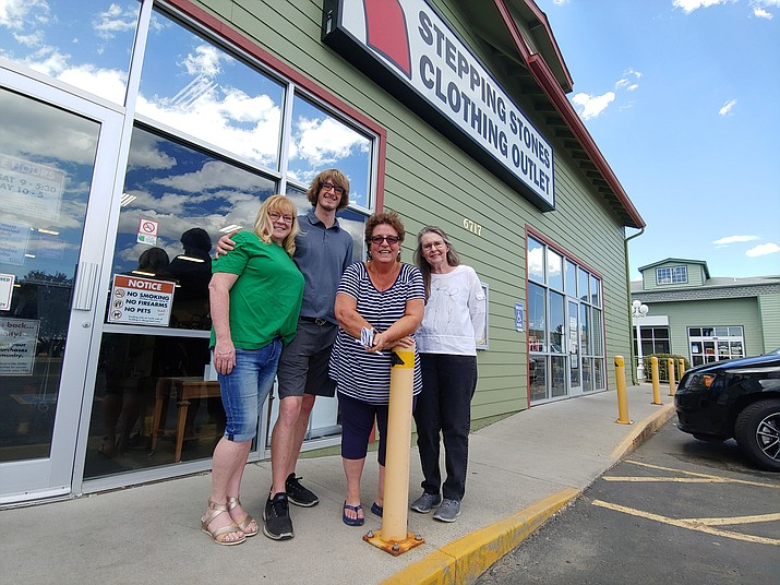 From left, Khristine Davenport and Blake Davenport of $6 Deals, Stepping Stones CEO Robin Burke, and Armadilla Wax Works co-owner Denise Jenike are switching their brick-and-mortar locations as part of a group arrangement. (Doug Cook/Courier)