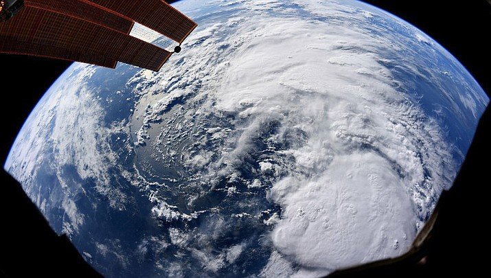 This file satellite image provided by NASA and taken by U.S. astronaut Christina Koch on Thursday at the International Space Station, shows Tropical Storm Barry as it bears down on Texas, Louisiana, Alabama and the panhandle of Florida as it makes its way through the Gulf of Mexico. (Photo courtesy of Christina Koch/NASA)