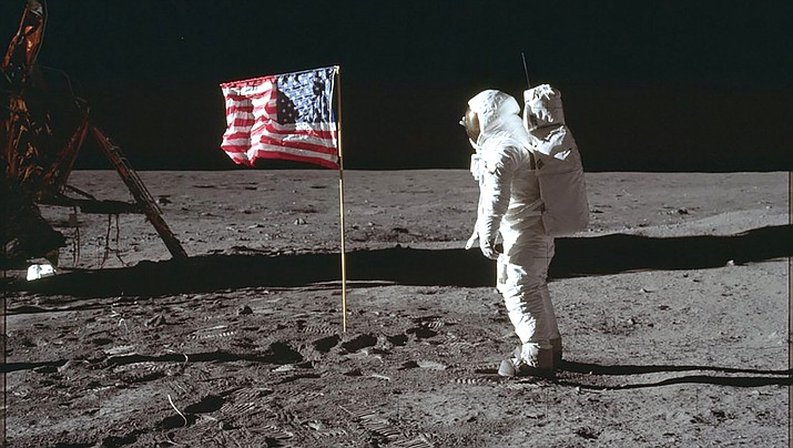 Buzz Aldrin Jr. poses for a photograph beside the U.S. flag on the moon during the Apollo 11 mission. (Photo courtesy of Neil Armstrong/NASA)