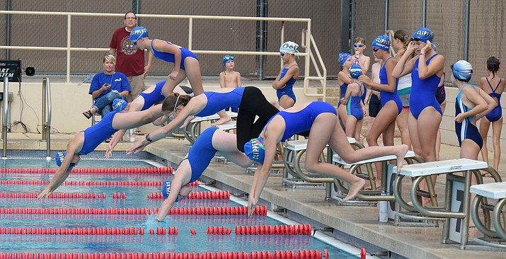 Members of the Cottonwood Clippers' B team dive in the pool in the 50-yard butterfly on Friday night at the Cottonwood Aquatics Center during their leg of the Red, White & Blue Meet. VVN/James Kelley