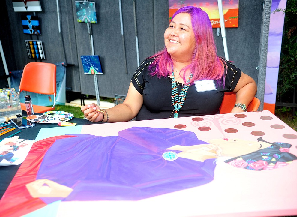 Navajo painter Jerilynn Yazzie smiles as she answers questions at the Prescott Indian Arts Market at the Sharlot Hall Museum Saturday July 13, 2019. For a short video of the event go to dCourier.com..The show continues Sunday. (Les Stukenberg/Courier)