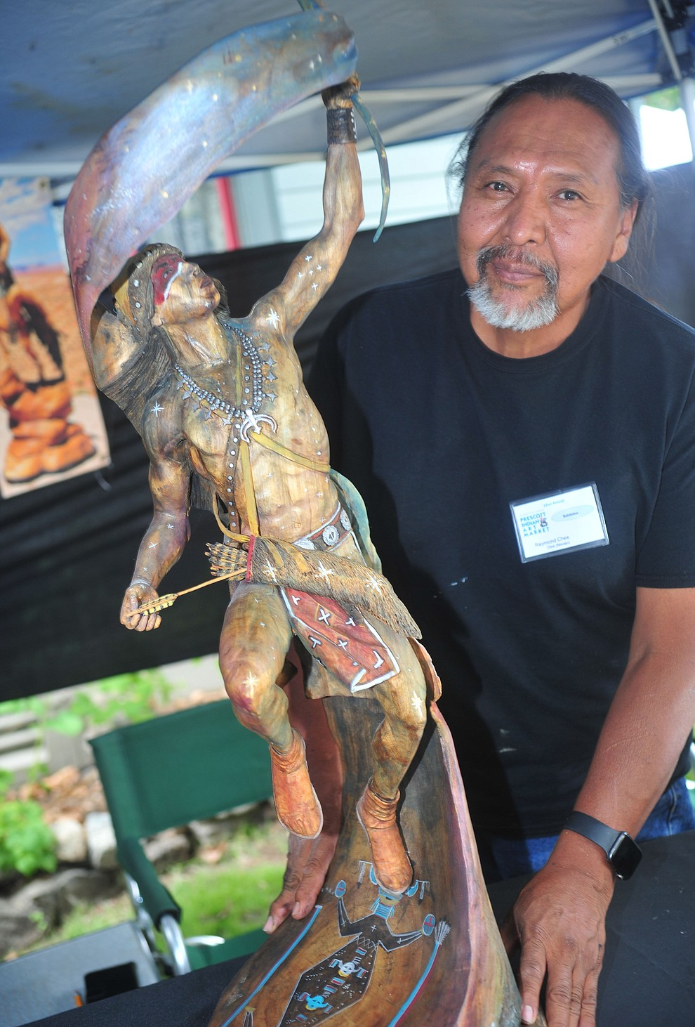 Raymond Chee poses with his sculture reminiscent of Orionat the Prescott Indian Arts Market at the Sharlot Hall Museum Saturday July 13. For a short video of the event go to dCourier.com. The show continues Sunday, July 14. (Les Stukenberg/Courier)