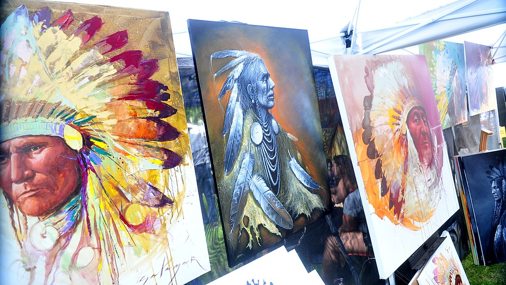 Navajo painter Jeremy Salazar's work on display at the Prescott Indian Arts Market at the Sharlot Hall Museum Saturday July 13, 2019. For a short video of the event go to dCourier.com..The show continues Sunday. (Les Stukenberg/Courier)