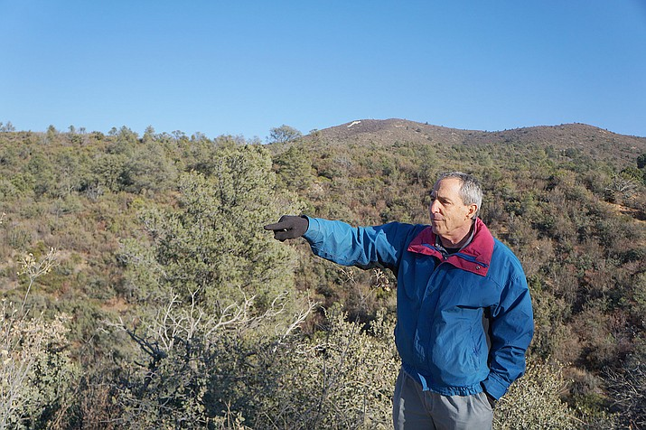 Local businessman Howard Mechanic points out the land along Overland Trail in the Government Canyon area where he plans to develop a residential project. A July 9 settlement of a lawsuit with the City of Prescott secured the right to city water for the 195-home project. (Cindy Barks/File/Courier)