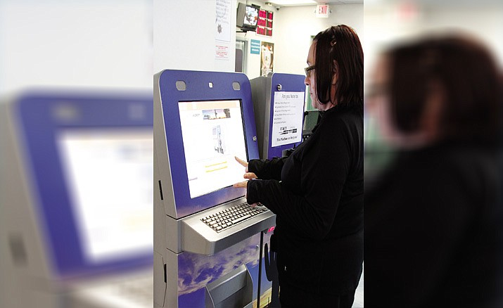 This is a file photo of a demonstration of the self-service kiosk at Motor Vehicles Division - Kingman that took place in April 2017. The kiosk can now be a good source for people watching when waiting your turn at the MVD. (Daily Miner file photo)