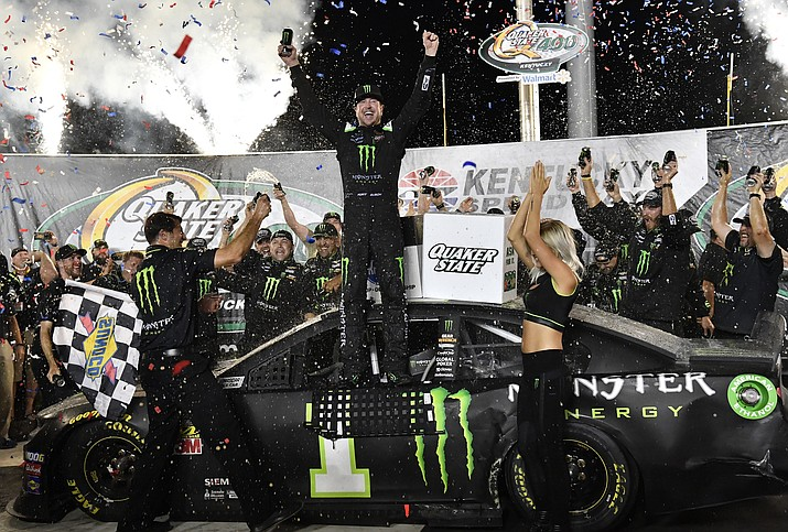 Kurt Busch celebrates his win in the NASCAR Cup Series at Kentucky Speedway in Sparta, Ky., Saturday, July 13, 2019. (Timothy D. Easley/AP)