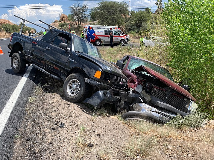 A 62-year-old woman was sent to the hospital for precautionary purposes after two trucks collided on Highway 89 near Granite Gardens Dr. on Sunday, July 14, 2019, in Prescott. (Prescott Fire/Courtesy)