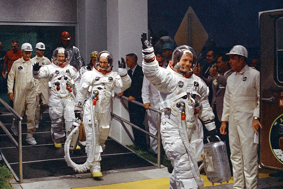 FILE - In this July 16, 1969 file photo, from right, Neil Armstrong, Michael Collins and Buzz Aldrin walk to the van that will take the crew to the launchpad at Kennedy Space Center on Merritt Island, Florida. (AP Photo/File)