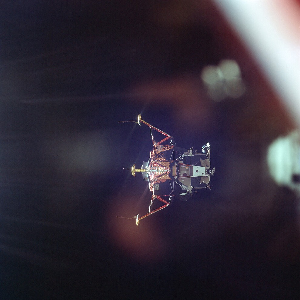In this July 20, 1969 photo made available by NASA, the Apollo 11 Lunar Module undocks from the Command Module on its way to the surface of the moon. (Michael Collins/NASA via AP)