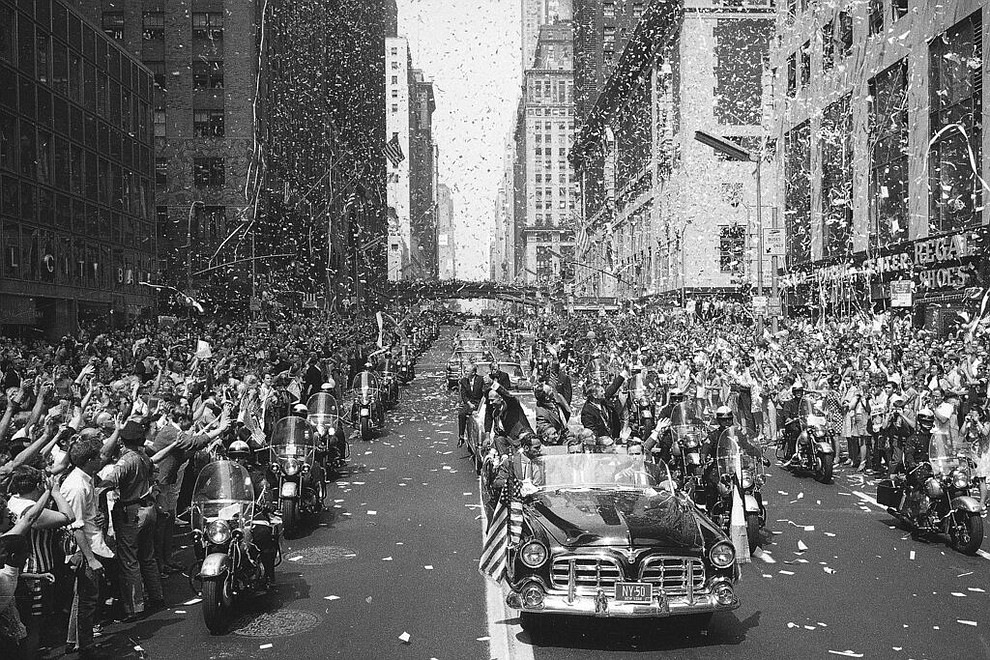 FILE - In this Aug. 13, 1969 file photo, people line 42nd Street in New York to cheer Apollo 11 astronauts, in lead car from left, Buzz Aldrin, Michael Collins and Neil Armstrong, traveling east on 42nd street, towards the United Nations. (AP Photo/File)