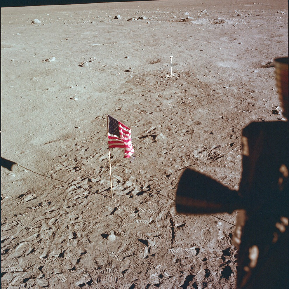 This July 21, 1969 photo made available by NASA shows Tranquility Base and the U.S. flag from a window on the Lunar Module as Neil Armstrong and Buzz Aldrin prepare for liftoff from the surface of the moon. (NASA via AP)