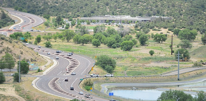 Traffic moves along Prescott Lakes Parkway on Thursday, July 11, 2019, at the proposed site for the Yavapai County Detention Center in Prescott. (Les Stukenberg/Courier)