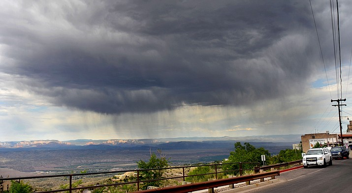Jerome only got a few sprinkles as this monsoon seemed to keep north toward Sedona and Sycamore Canyon from a photo taken from Jerome Thursday afternoon. Residents in the Verde Valley are awaiting monsoon season as temperatures were over 100 degrees in Cottonwood again Saturday. VVN/Vyto Starinskas