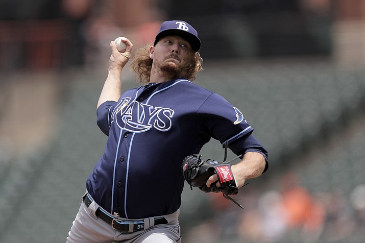 Tampa Bay Rays starting pitcher Ryne Stanek throws to a Baltimore Orioles batter during the first inning of a baseball game, Sunday, July 14, 2019, in Baltimore. (Julio Cortez/AP)