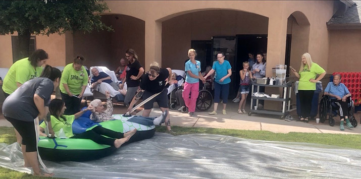 Nursing home residents have their turn to slip and slide