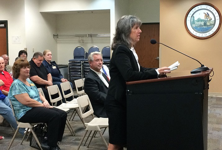 Mary Mallory, applicant for the vacant seat for District 5 Yavapai County supervisor, speaks to the Yavapai County Board of Supervisors Monday, July 15, before her appointment to the position. Fellow applicant Chris Howard sits in the front row behind Mallory. (Sue Tone/Courier)
