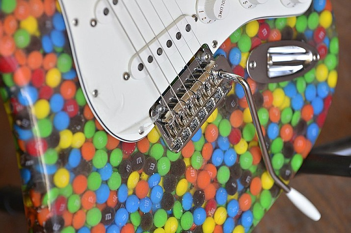 This photo shows a detail of the M&M's guitar that Brian King of Norfolk built. The guitar took about 80 hours in total, he said. (Darin Epperly/The Norfolk Daily News via AP)
