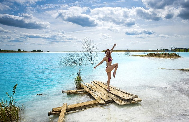 In this undated handout photo taken by mrwed54, a woman poses for a photo by a lake in the Siberian city of Novosibirsk, about 2,800 kilometers (1,750 miles) east of Moscow, Russia. (mrwed54 via AP)