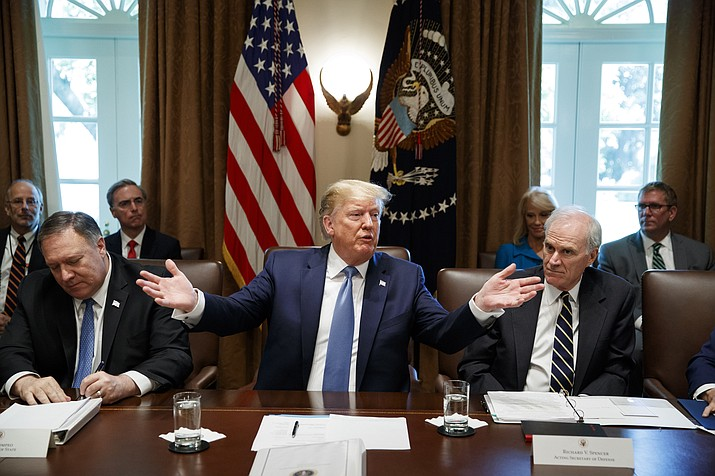 President Donald Trump speaks during a Cabinet meeting in the Cabinet Room of the White House, Tuesday, July 16, 2019, in Washington. Trump is accompanied by Secretary of State Mike Pompeo, left, and acting Defense Secretary Richard Spencer. (Alex Brandon/AP)