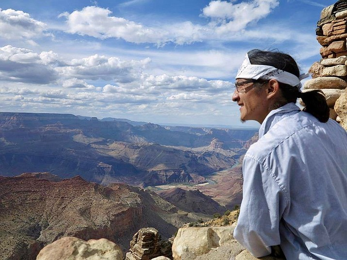 Ed Kabotie looks over the rim of the Grand Canyon. Kabotie is putting on an event called Rumble on the Rim, which will raise awareness of the plight of the indigenous people of the Colorado Plateau. (Photo courtesy of Sarah Weatherby)