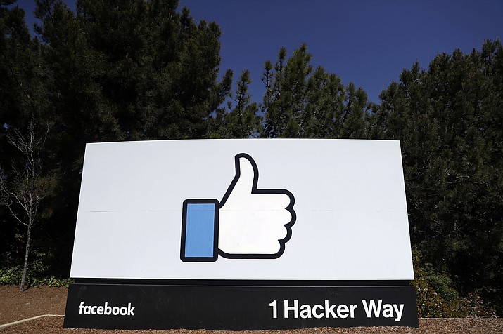 FILE - This March 28, 2018, file photo shows a Facebook logo at the company's headquarters in Menlo Park, Calif. Facebook's ambitious plan to create a new financial system based on a digital currency faces questions from lawmakers, as it's shadowed by negative comments from President Donald Trump, his Treasury secretary and the head of the Federal Reserve. (AP Photo/Marcio Jose Sanchez, File)