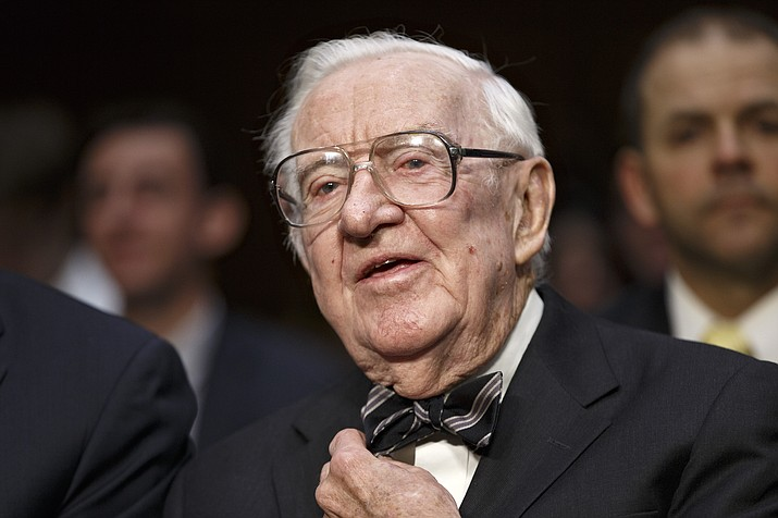 In this April 30, 2014 file photo, retired Supreme Court Justice John Paul Stevens prepares to testify on the ever-increasing amount of money spent on elections as he appears before the Senate Rules Committee on Capitol Hill in Washington. Stevens, the bow-tied, independent-thinking, Republican-nominated justice who unexpectedly emerged as the Supreme Court's leading liberal, died Tuesday, July 16, 2019, in Fort Lauderdale, Fla., after suffering a stroke Monday. He was 99. (AP Photo, File)