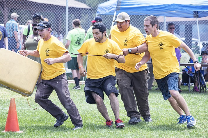The Xanterra Engineering Department works hard to win the first place award in the Four Stooges event during the 24th annual Xanterra Property Olympics July 13. From left: Eddie Adrian, Franco Traverso, Rivers Jones and Aaron Faith. (Veronica Tierney/WGCN)