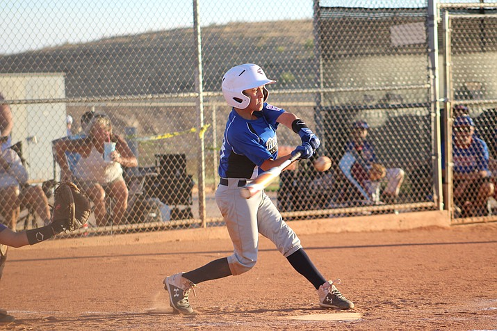 Prescott's Taylor Keppel connects on a RBI single during an eight-run fourth inning. Prescott went on to beat Lake Havasu City 10-0 in four innings. Next up for Prescott is an elimination contest against Litchfield Park at 5:30 p.m. Wednesday. (Photo by Beau Bearden/Kingman Daily Miner)