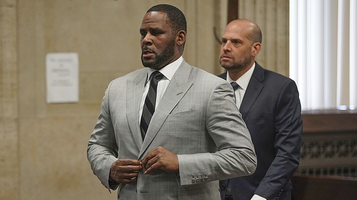In this June 6, 2019, file photo, singer R. Kelly pleaded not guilty to 11 additional sex-related felonies during a court hearing before Judge Lawrence Flood at Leighton Criminal Court Building in Chicago. Kelly, who was arrested in Chicago on July 11, 2019 on a federal grand jury indictment listing 13 counts including sex crimes and obstruction of justice, was ordered held without bond on Tuesday, July 16. (E. Jason Wambsgans/Chicago Tribune via AP, Pool)