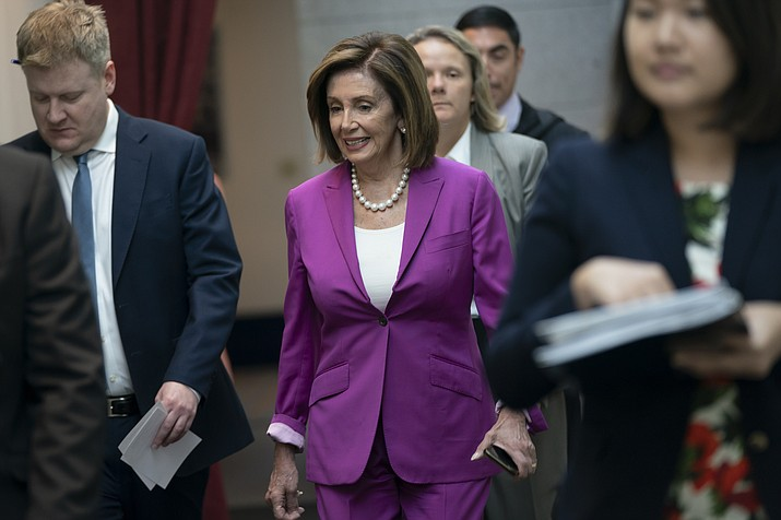 "House Speaker Nancy Pelosi, D-Calif., arrives for a closed-door session with her caucus before a vote on a resolution condemning what she called ""racist comments"" by President Donald Trump at the Capitol in Washington, Tuesday, July 16, 2019. His remarks were directed at Reps. Ilhan Omar of Minnesota, Alexandria Ocasio-Cortez of New York, Ayanna Pressley of Massachusetts and Rashida Tlaib of Michigan. (AP Photo/J. Scott Applewhite)"