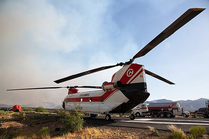 The Woodbury Fire near Superior began June 8 and now is 90 percent contained. Firefighters employed a CH47D helicopter, which carries a water bucket that holds up to 2,800 gallons, to battle the blaze. (Anton L. Delgado/News21, via Cronkite News)