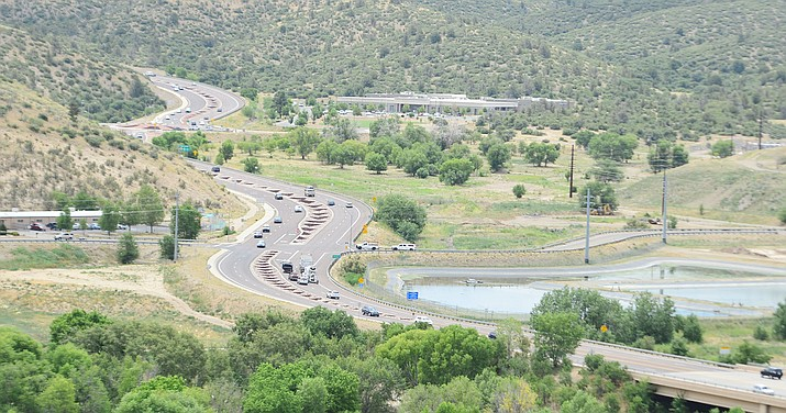 Traffic moves along Prescott Lakes Parkway at the proposed site for the Yavapai County Detention Center in Prescott last week. The jail construction will cost county property owners and 18.1 percent hike in taxes. (Les Stukenberg/Courier)