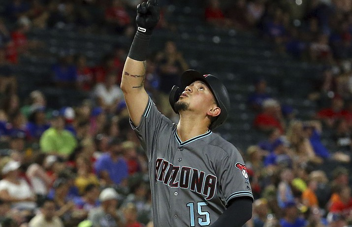 Arizona Diamondbacks Ildemaro Vargas gestures as he approaches home plate after a two-run home run against the Texas Rangers during the sixth inning of a game Tuesday, July 16, 2019. in Arlington, Texas. (Richard W. Rodriguez/AP)