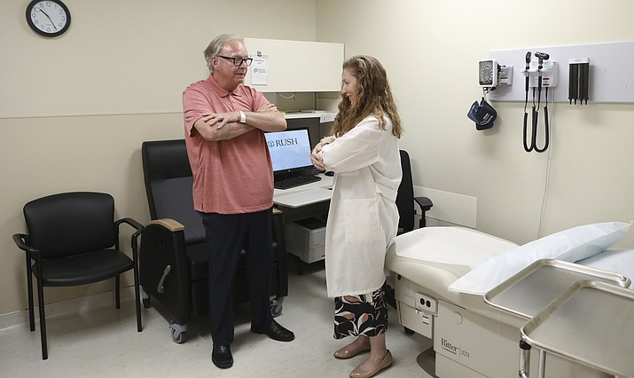 Dr. Jori Fleisher, neurologist, examines Thomas Doyle, 66, July 9, 2019, at the Rush University Medical Center in Chicago. (Teresa Crawford/AP)