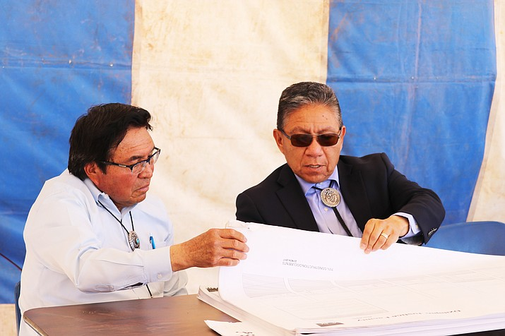 Navajo Nation Vice President Myron Lizer (right) looks over information provided regarding a new courthouse in Pinon.  (Submitted photo)
