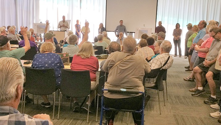 About 150 people showed up at a public meeting June 8 at the Prescott Valley Public Library to hear about a rezoning request for property located at the southeastern corner of Fain Road and Highway 69. (Sue Tone/Tribune)