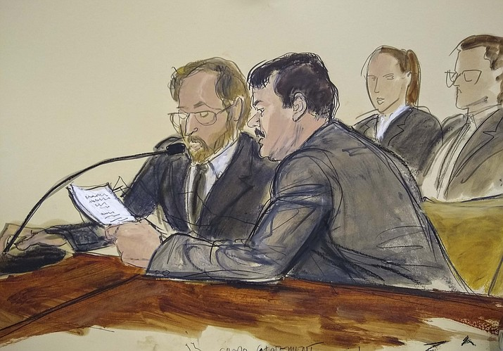 """In this courtroom sketch, Joaquin """"El Chapo"""" Guzman, foreground right, reads a statement through an interpreter during his sentencing in federal court, Wednesday, July 17, 2019, in New York. The Mexican drug kingpin, who was convicted in February 2019 on multiple conspiracy counts in an epic drug-trafficking case, was sentenced to life behind bars in a U.S. prison Wednesday. (Elizabeth Williams via AP)"""