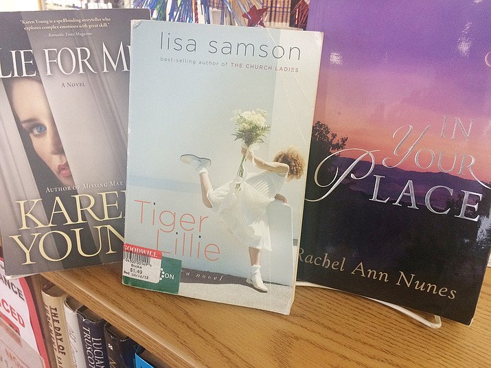 Three books on sale at the Chino Valley Public Library as part of the Summer Reading Fiction Sale. Paperback and hardback books are 50 cents through the end of August and all proceeds benefit the Chino Valley Library, 1020 W. Palomino Road. (Jason Wheeler/Review)
