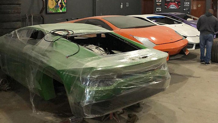 This photo released by Itajai Civil Police, shows car molds of luxury car replicas at a workshop in Itajai, Brazil. (Itajai Civil Police via AP)