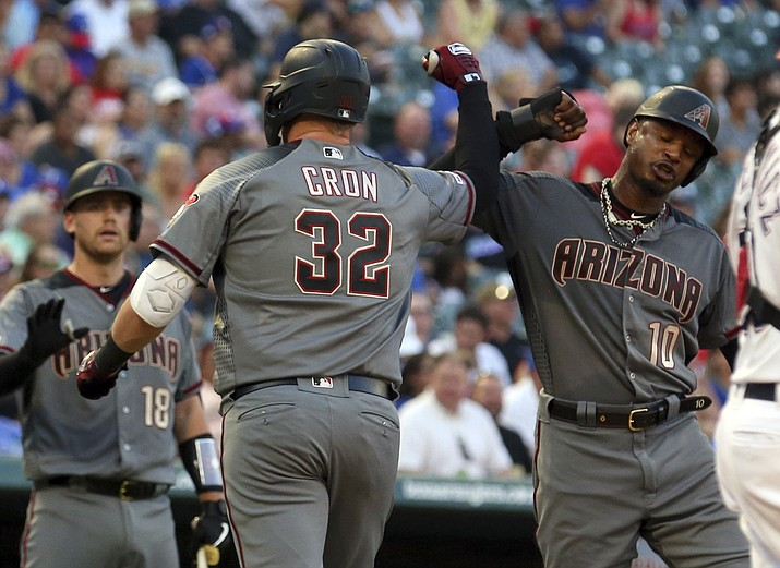 Arizona D-backs first baseman Kevin Cron (32) is greeted by Adam Jones (10) after a three-run homer in the second inning of a game against the Texas Rangers Wednesday, July 17, 2019, in Arlington, Texas. (Richard W. Rodriguez/AP)
