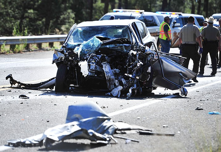 The front end of a compact SUV was smashed in and its driver was killed in a crash on Iron Springs Road Thursday afternoon, July 18. (Les Stukenberg/Courier)
