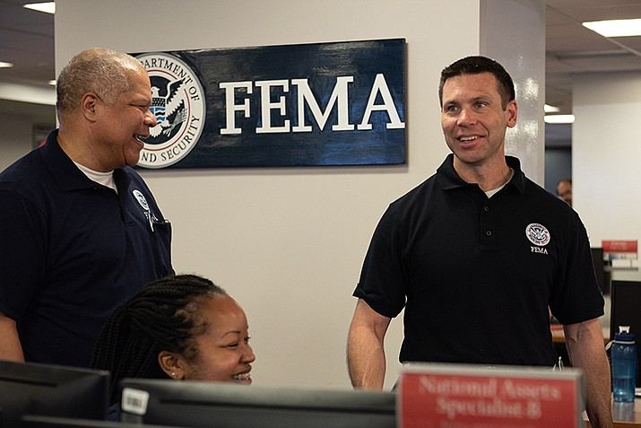 Acting Homeland Security Secretary Kevin McAleenan, right, visits FEMA's National Response Coordination Center for a briefing on Tropical Storm Berry on July 11. (Photo by Tim Godbee/DHS)