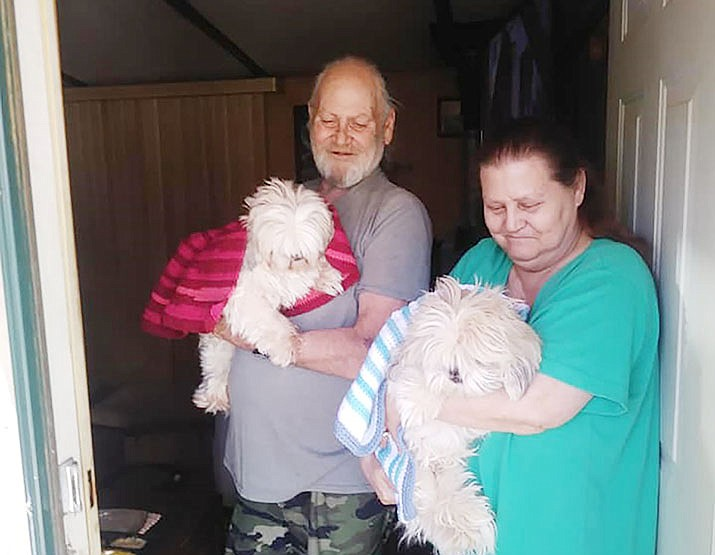 Happy pet owners and their dogs after receiving blankets. (Courtesy)