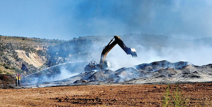 Forest Service water crews and a hired excavator continued to spray water on the large burning mulch pile several miles east of Camp Verde. It will burn another week or two, officials say. VVN/Vyto Starinskas