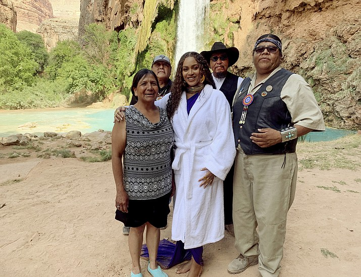 "Havasupai tribal Chairwoman Muriel Uqualla, from left, Councilman Richard Watahomigie, Beyoncé, Councilman Claudius Putesoy and Vice Chairman Matthew Putesoy on July 10, 2019. in Supai. Beyoncé filmed part of her latest music video, ""Spirit"" in front of Havasu Falls on the tribe's land. (Parkwood Entertainment via AP)"