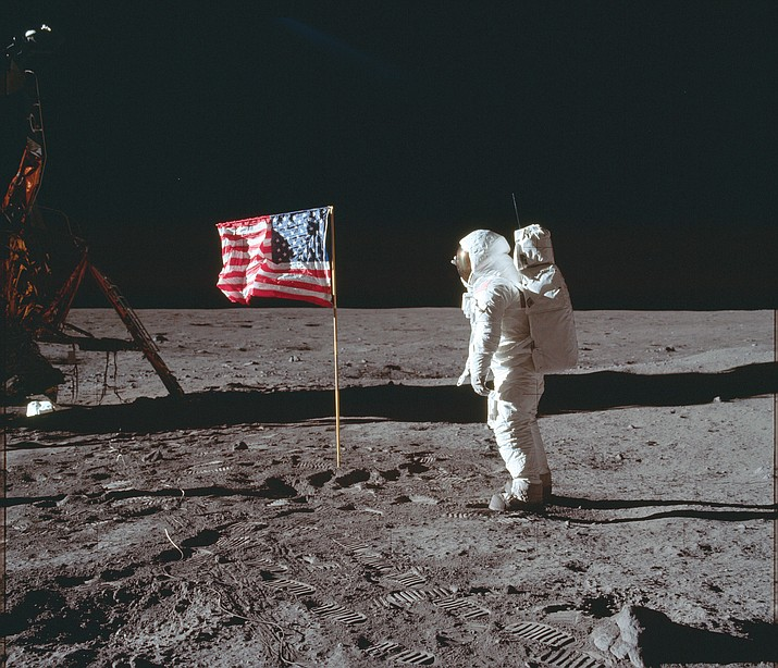 Astronaut Buzz Aldrin Jr. poses for a photograph beside the U.S. flag on the moon July 20, 1969, during the Apollo 11 mission. (Neil Armstrong/NASA via AP)